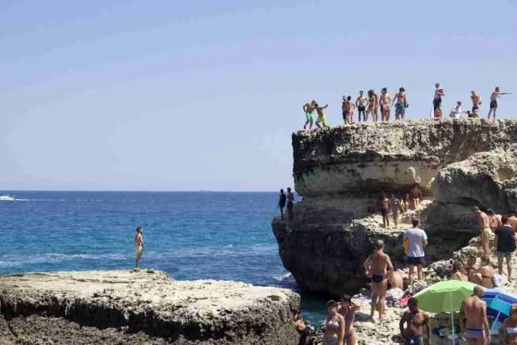 Cliff jumping at the Grotta della Poesia in Puglia