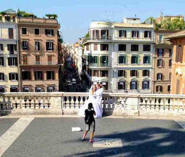 Bride and groom on the Spanish Steps in Rome