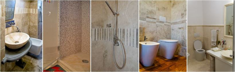 Esempi di bagni con decori in mosaici e listelli in travertino