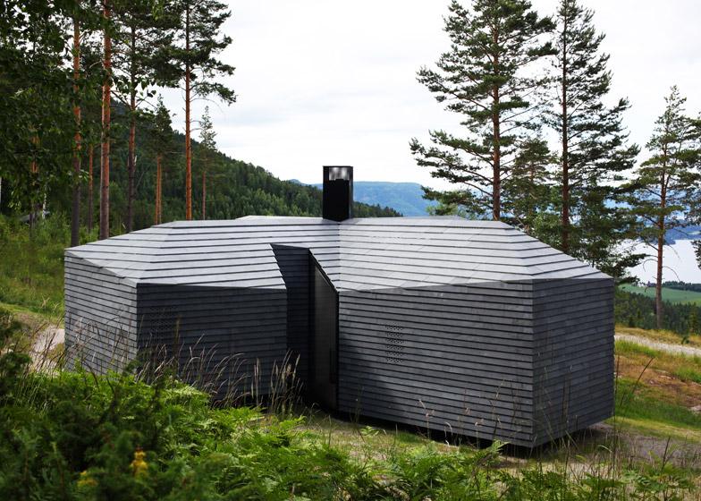 cabina su lago in norvegia rivestimenti in basalto