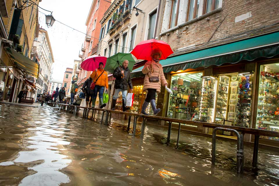 Life marches on even during higher than normal flooding in Venice.