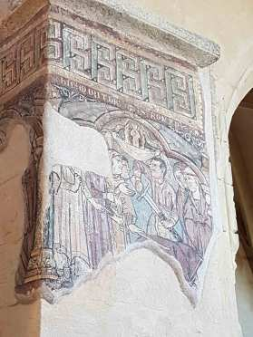 Cette fresque représente le martyr de Saint Romain d'Antioche