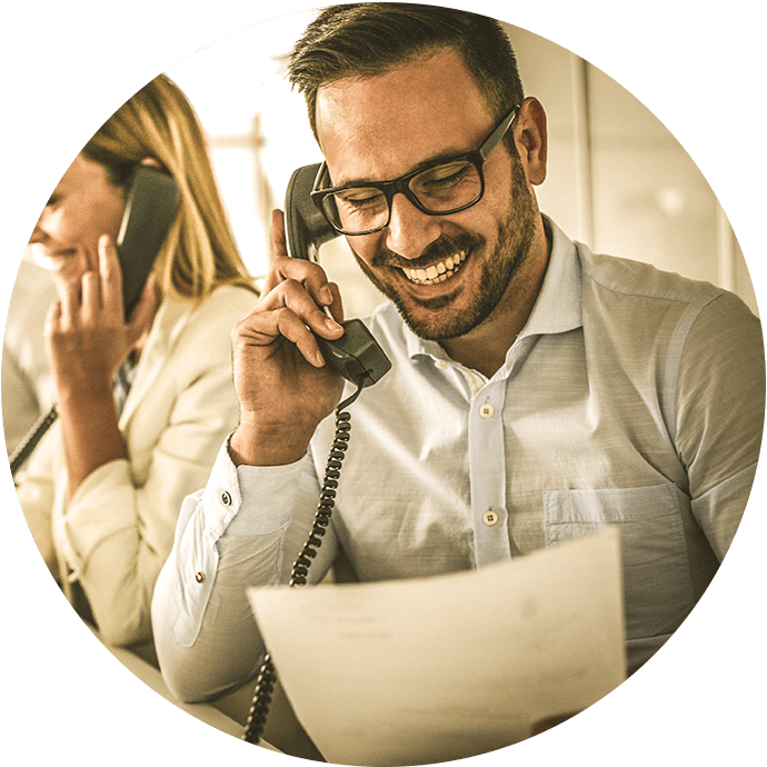 Man on phone at business communicating with clients