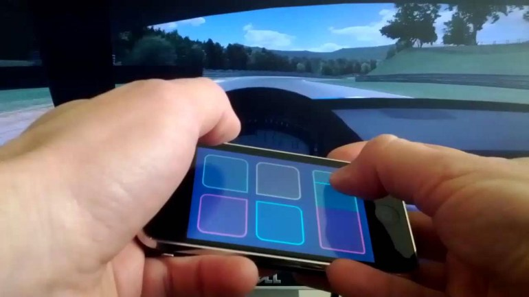 """Ford запатентовал способ управления беспилотным автомобилем с помощью смартфона, который превращается в """"виртуальный руль"""" из автосимулятора"""