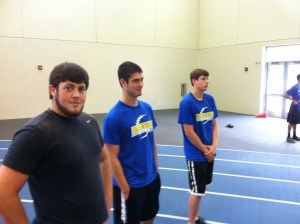 High school shot putters trying to look intelligent and...not succeeding.