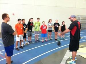 Coach Denard introducing the weight throw.