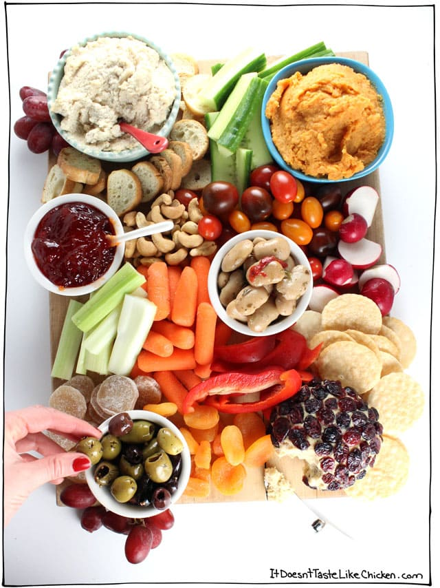 Cheese board shmeeze board. Spice up your party with this guide of How to Make a Vegan Snack Board. Homemade or store-bought, this appetizer platter is quick and easy to assemble, but is sure to impress! #itdoesnttastelikechicken