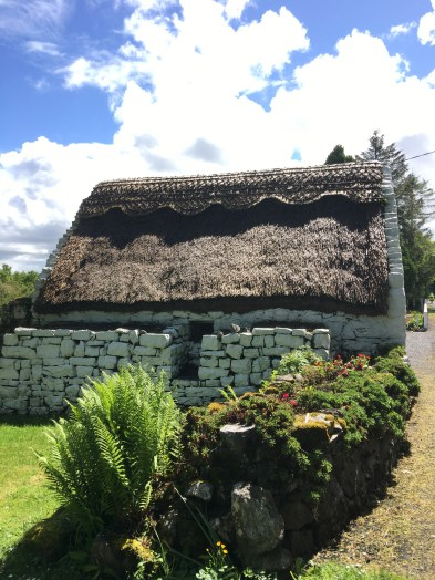 older stone building with thatch