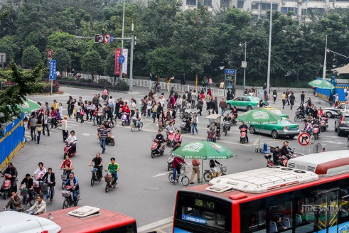 Chengdu intersection with cars, scooters and people