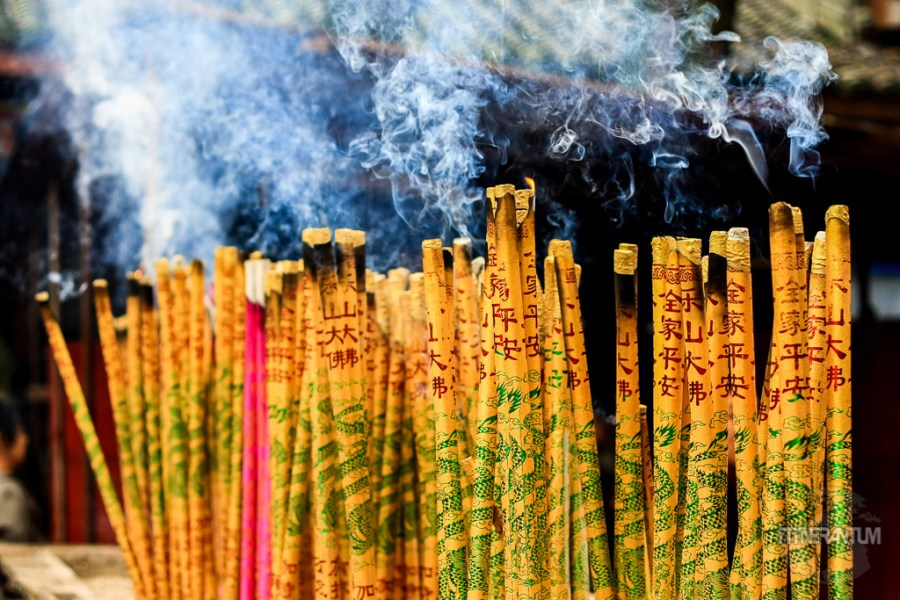 Burning incense sticks in a temple in Chengdu