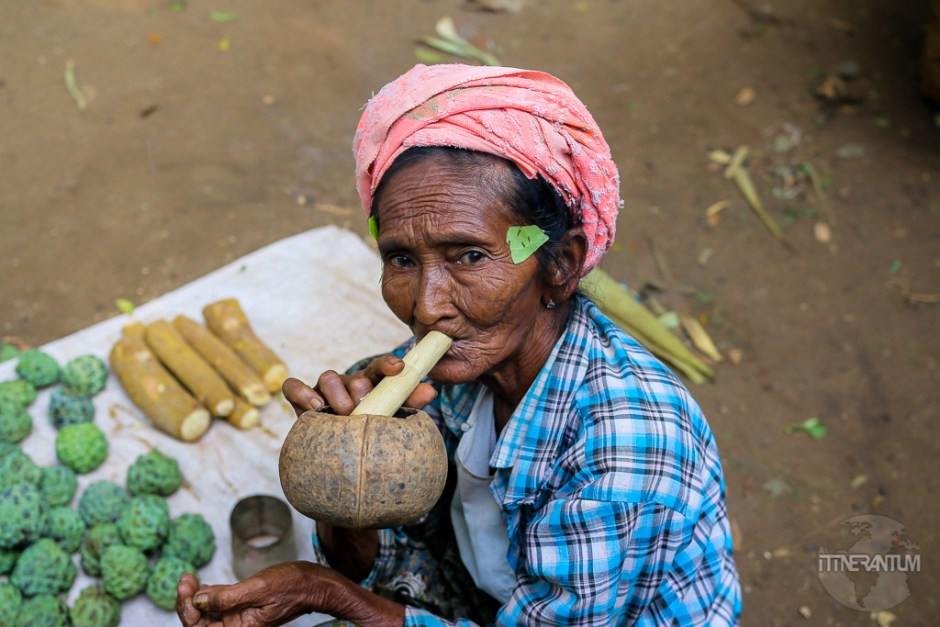 old lady smoking pipe in myanmar