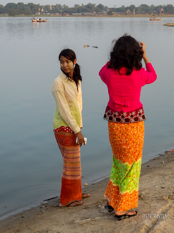 Girls trying to capture U-bein bridge in the best light, people of myanmar