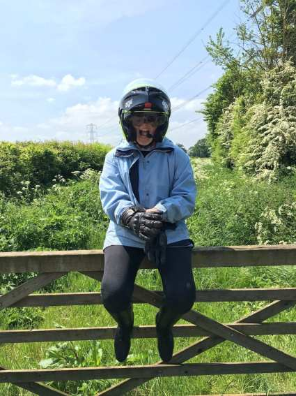 Natalia after first pillion ride with a borrowed AGV compact helmet and oversized gloves