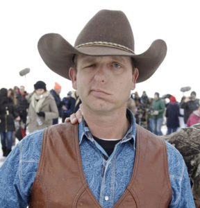 Ryan Bundy, one of the sons of Nevada rancher Cliven Bundy, walks to a news conference at Malheur National Wildlife Refuge Thursday, Jan. 7, 2016, near Burns, Ore. A small, armed group occupying the wildlife preserve has said repeatedly that local people should control federal lands, but critics say the lands are already managed to help everyone from ranchers to recreationalists. (AP Photo/Rick Bowmer)