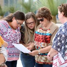 Carol Bundy, second right, wife of rancher Cliven Bundy, and her daughters Stetsy Cox, left, and Bailey Louge, second left, read the jury's verdict outside the Lloyd George U.S. Courthouse on Monday, April 24, 2017, in Las Vegas. Bizuayehu Tesfaye Las Vegas Review-Journal @bizutesfaye