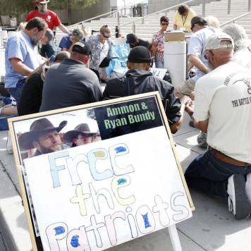 Supporters pray outside the Lloyd George U.S. Courthouse as they await the jury's verdict in the first Bunkerville standoff trial on Monday, April 24, 2017, in Las Vegas. Bizuayehu Tesfaye Las Vegas Review-Journal @bizutesfaye