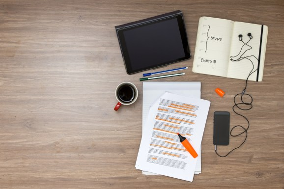 Exam week background, with various study and educted related items, such as a highlighted reader with standard (lorum ipsum) text, a cup of coffee, electronic tablets, music player and ear plugs, and a calendar with the exam date marked