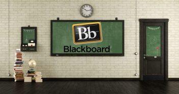 Empty retro classroom with blackboards.wooden door and books on hardwood floor - 3d rendering
