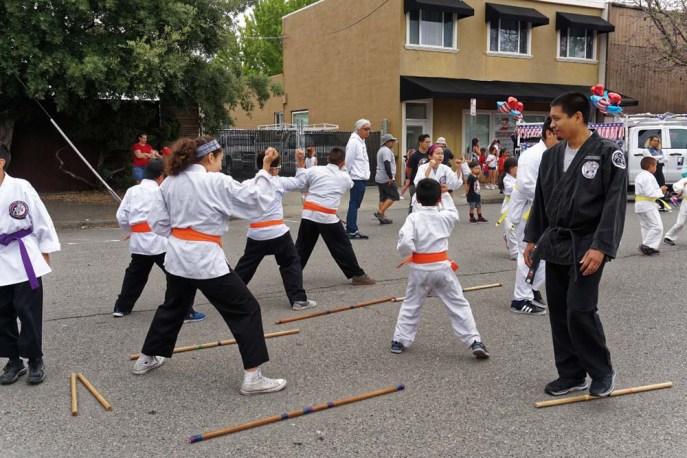 Orange belts giving parade demonstration