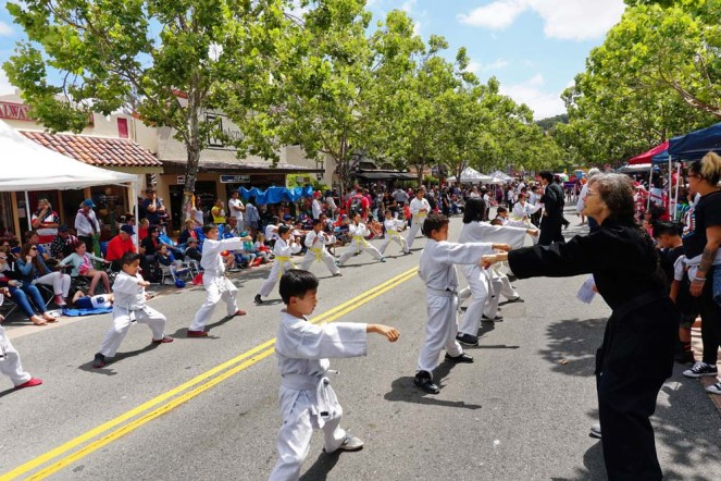 Kids performing karate moves on road