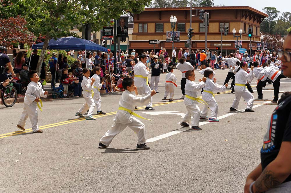 Yellow belt students at parade giving demo