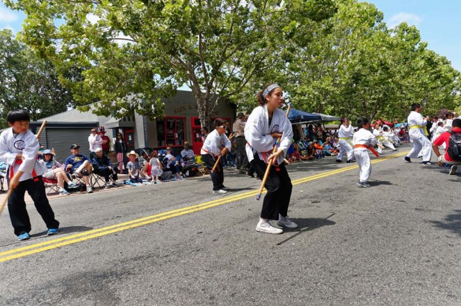 Kids showing bo staff skills at parade