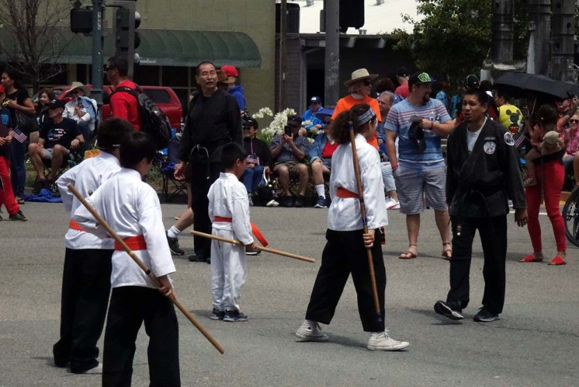 Red belts with bo staffs