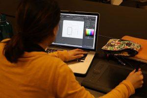Emily at the computer designing schematics in Illustrator