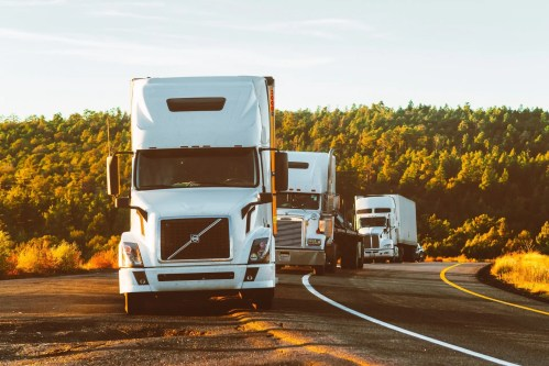 white-volvo-semi-truck-on-side-of-road