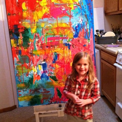 Posing with family art (making art with kids).