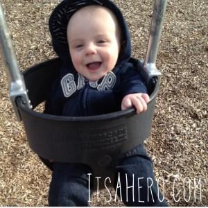 Happy Swinging boy