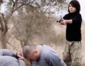 The boy shoots the captives in the head, then fires more rounds into them