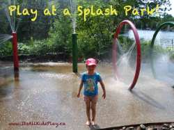 Children playing at a splash park in her clothes.