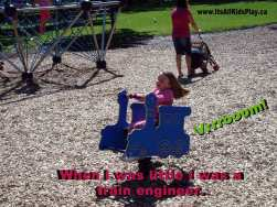 When I was a kid I was a train engineer. (Child on train toy in a park.)