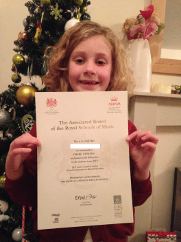 Proudly showing off her certificates
