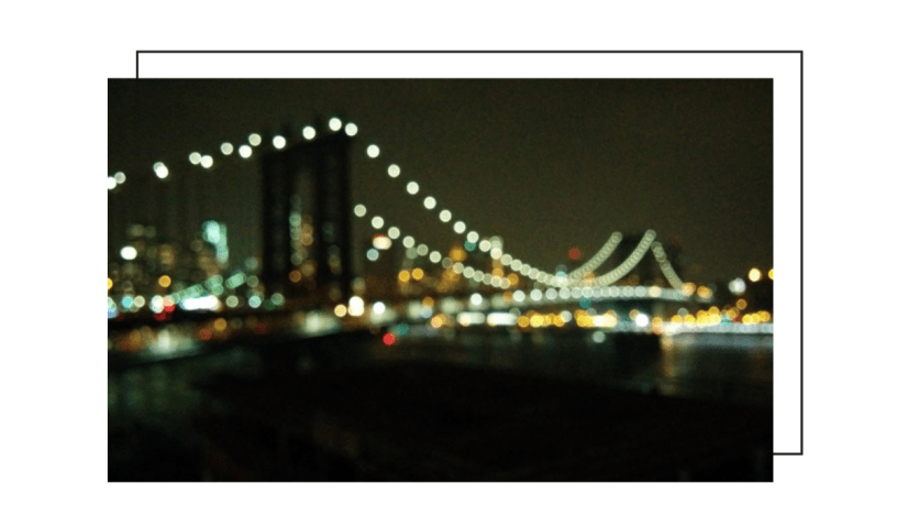 Brooklyn bridge at night with blurry lights