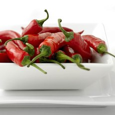 Calories: 30 per half cup Hot or mild, peppers are packed with vitamin C fiber for negligible calories. The heat in hot peppers signals the presence of capsaicin, a compound that, along with capsiate, can propel the body to scorch an extra 50 to 100 calories following a spicy meal. Go for: Chilies as hot as you can stand. (But watch out! The hottest ones—habanero, Scotch bonnet, and Thai or Indian peppers—are too fiery for many people.)