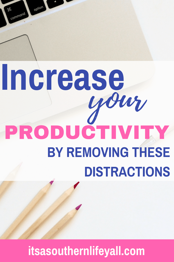 Laptop on desk with colored pencils and increase your productivity by removing these distractions text overlay - Stop Using Alt Tags for Pinterest Pin Descriptions