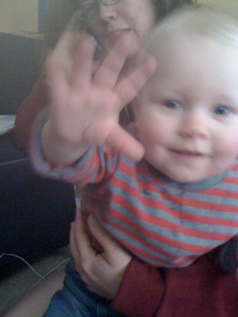 Baby E waving, eleven months old