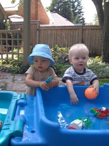 Baby E and friend, splashing
