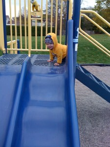 on the slide at the park