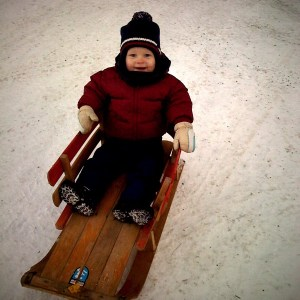 E on a sled at Cedar Haven, Boxing Day 2009