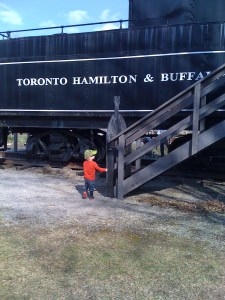 E checking out the train at Westfield Heritage Village
