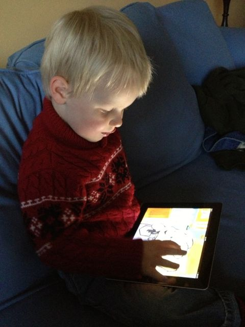 kid playing on the ipad