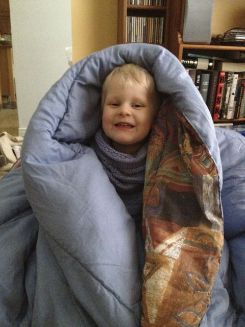 kid in a blanket