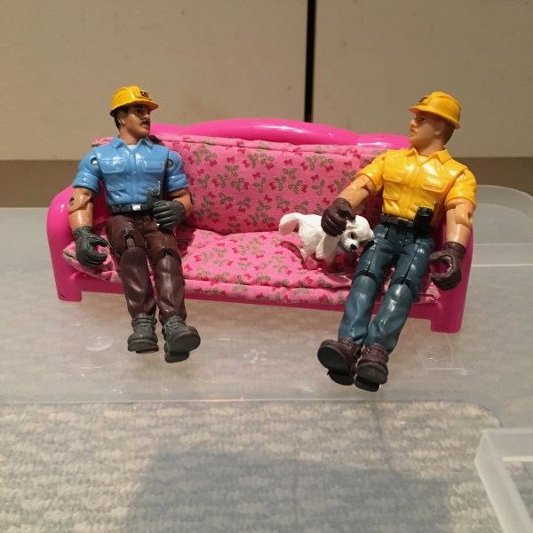 construction-worker-figures-sofa-dog