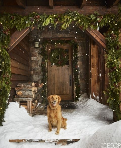 A Montana cabin's entrance decorated for Christmas by Ken Fulk, Photographed by Douglas Friedman