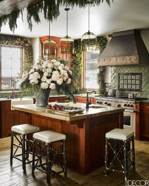 A Montana cabin's kitchen decorated for Christmas by Ken Fulk, Photographed by Douglas Friedman
