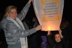 Theo and me, sending off the lantern in memory of my Mom and Dad, the grandparents he never knew. Photo by Don Neilson.