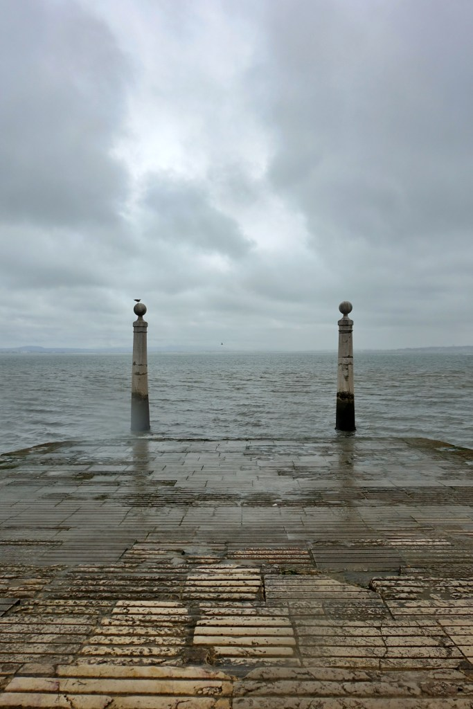 Cais das Colunas, Lisbon with grey clouds in background